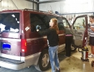 Hardworking-volunteers-cleaning-van-2014